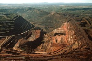 The biggest single-pit open-cut iron ore mine in the world, the BHP Biliton Mount Whaleback mine, 455 km (283 miles) south of Port Hedland is seen in this undated handout photograph obtained August 12, 2009. BHP Billiton Ltd, the world's largest miner, reported a 30 percent slide in annual profit excluding writedowns, its first fall in seven years, pummelled by a slump in metals prices and demand. REUTERS/BHP Biliton/Handout (AUSTRALIA BUSINESS ENVIRONMENT) FOR EDITORIAL USE ONLY. NOT FOR SALE FOR MARKETING OR ADVERTISING CAMPAIGNS
